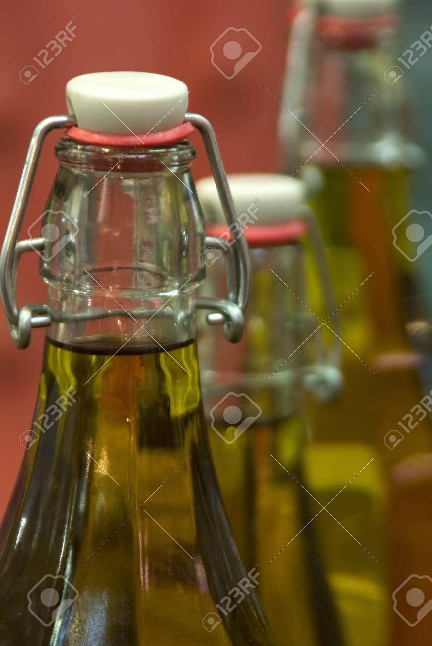 Close up of bottles of olive oil - 4382594
