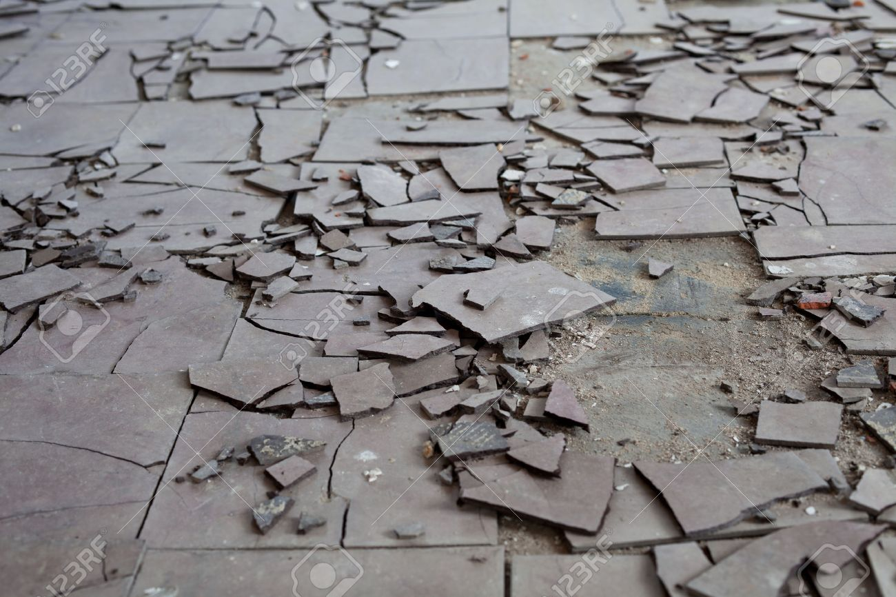 Old and broken asbestos floor tiles stock photo picture and old and broken asbestos floor tiles stock photo 24946892 dailygadgetfo Choice Image