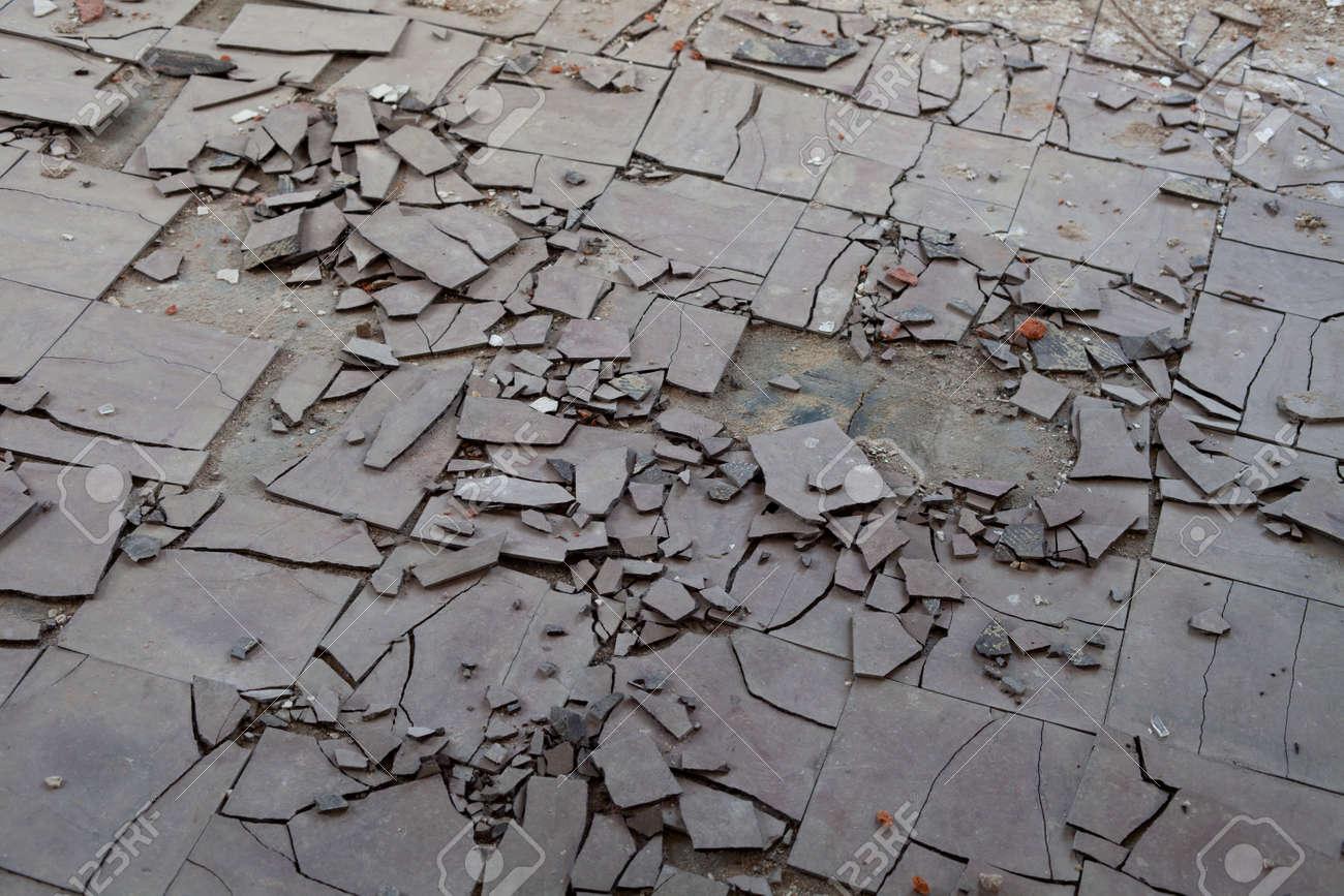 Old and broken asbestos floor tiles - 24946972