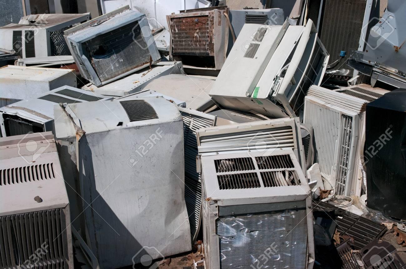 Dumped AC units in a scrapyard - 24955311