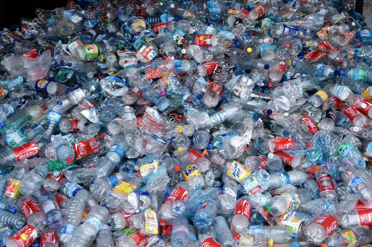TOULOUSE, FRANCE - CIRCA 2009: Clear plastic bottles lie in a heap at an undisclosed recycling facility circa 2009 in Toulouse. The plastic is gathered by color and type to be recycled. - 24957704