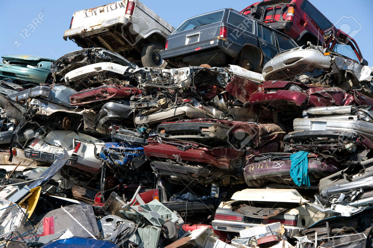 A pile of compressed cars going to be shredded - 24960366