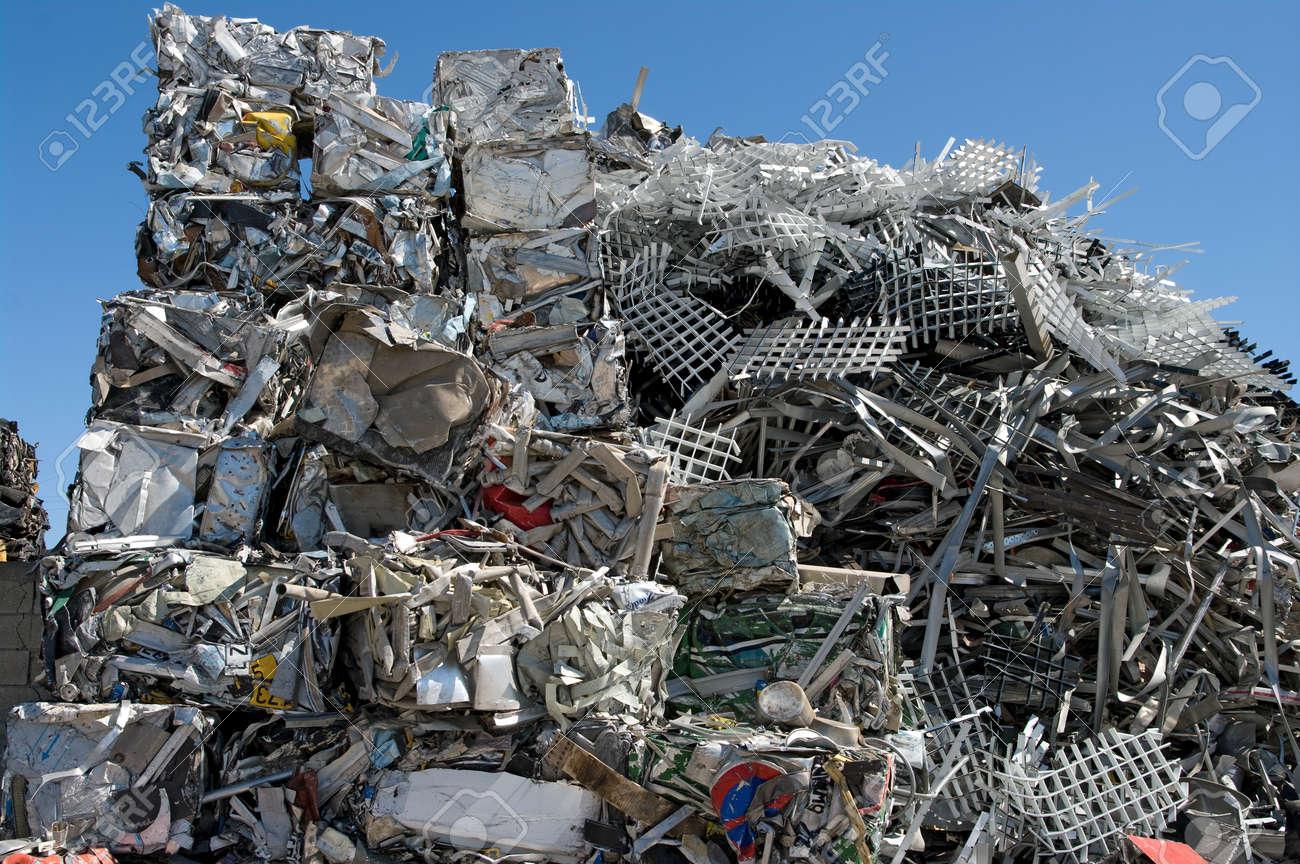 Pile of scrap metal in a scrapyard - 24960512