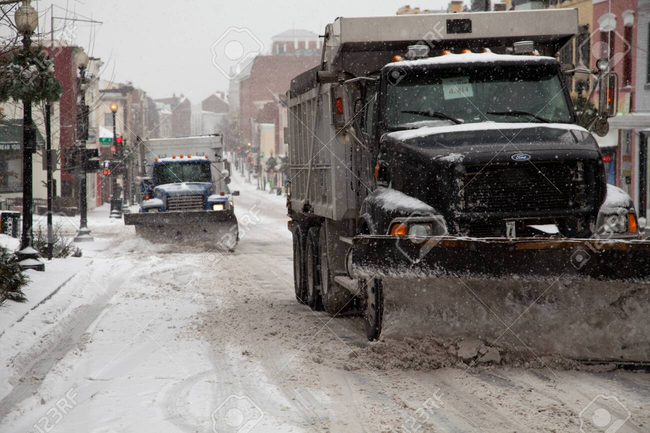 Trucks plowing Washington DC streets from the Winter storm on February 3, 2014 - 26761174