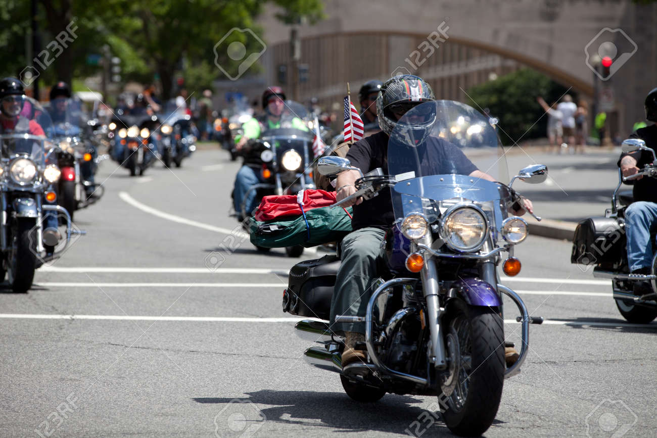 """Motorcycles travel in DC as part of the annual Rolling Thunder motorcycle """"Ride for Freedom"""" for American POWs and MIA soldiers on May 25, 2014 in Washington, DC. - 28661143"""