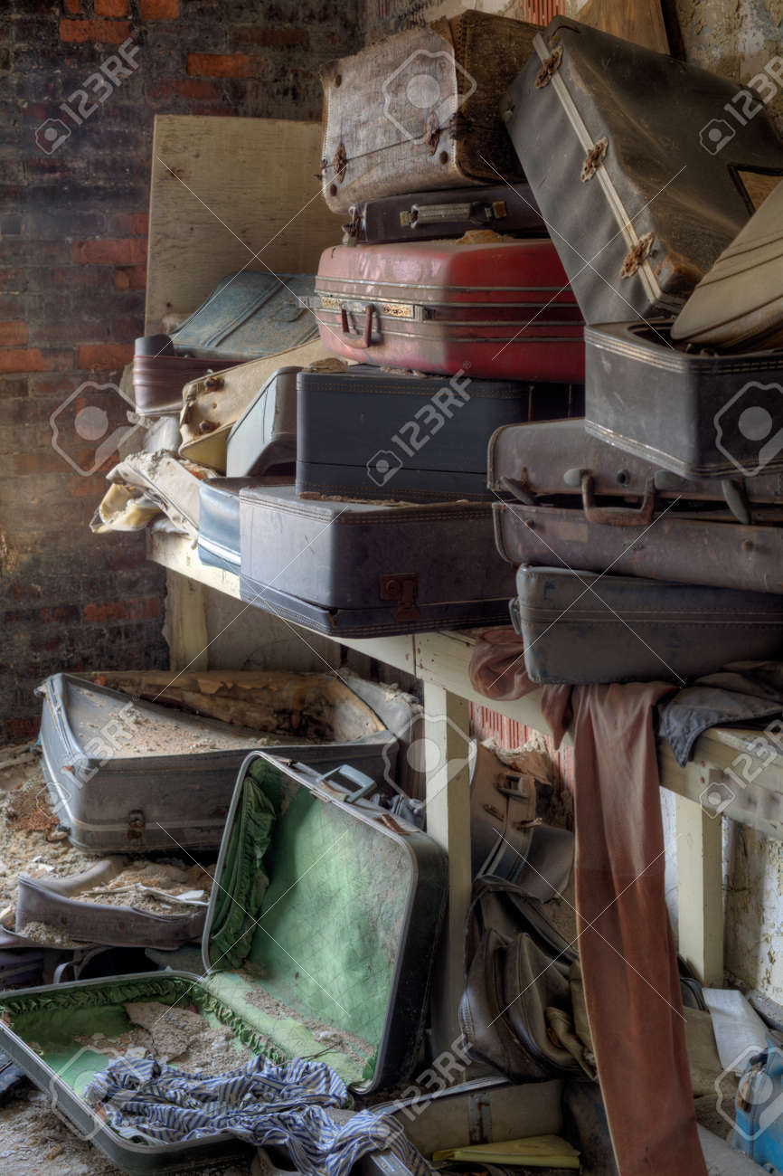 Urbex - empty, old and dirty suitcases, in light HDR processing - 30323078