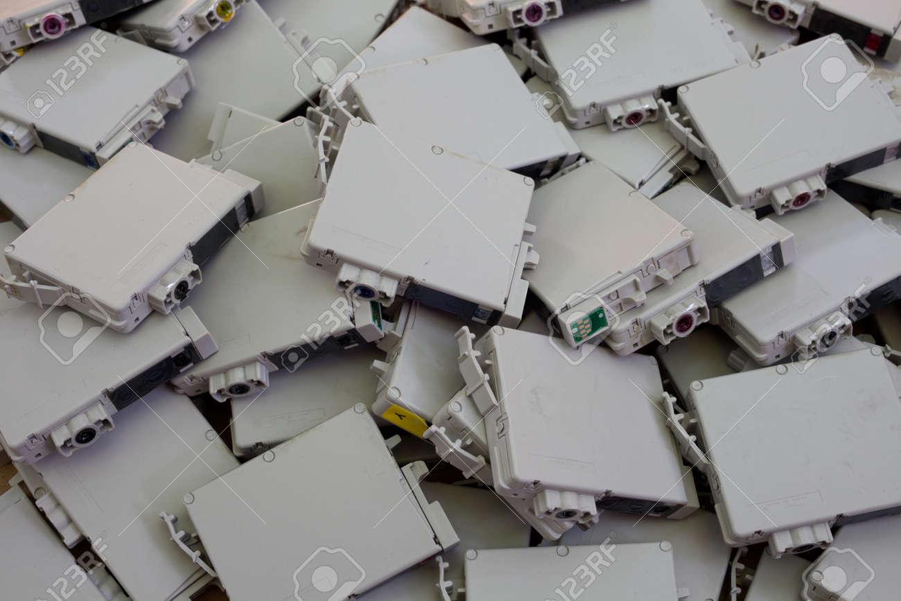 OEM, non-refillable, brand name inkjet printer cartridges lying in a heap - 30323080
