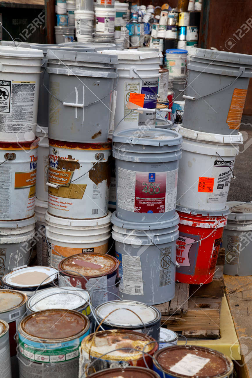Fairfax, VA, USA - December 5, 2013: Paint cans gathered in order to be recycled. They will be sorted out and the latex ones will be separated from the oil cans. Unlike oil paints, latex paints aren't considered hazardous waste and can be recycled with me - 30216965