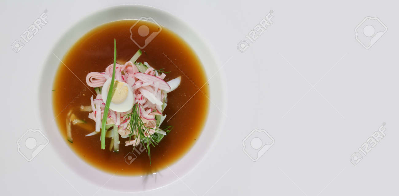 Kvass okroshka in a white plate.Copy space.View from above.Russian cold soup. - 140470551