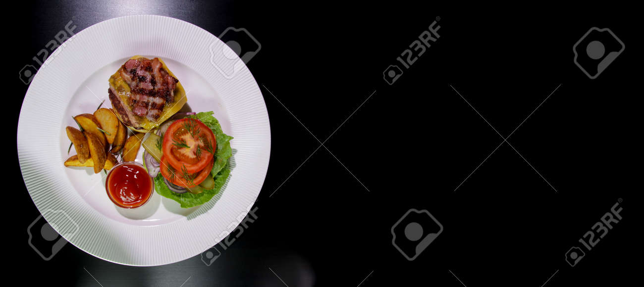 Isolated on a black background.View from above.Horizontal composition.Unhealthy food. - 142255464