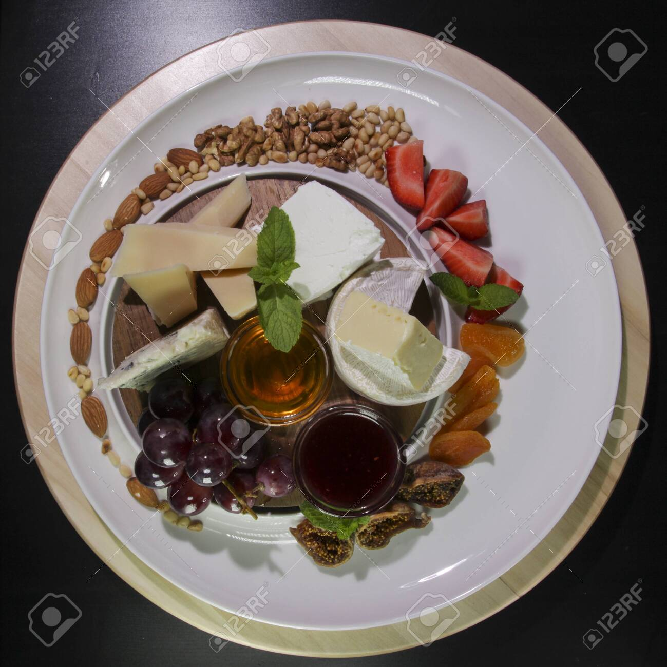 Cheese plate.Isolated on a black background.View from above. - 142255471