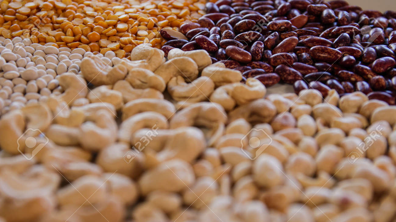 Close-up of dry red and white beans and yellow peas, cashews and peanuts. - 142921485