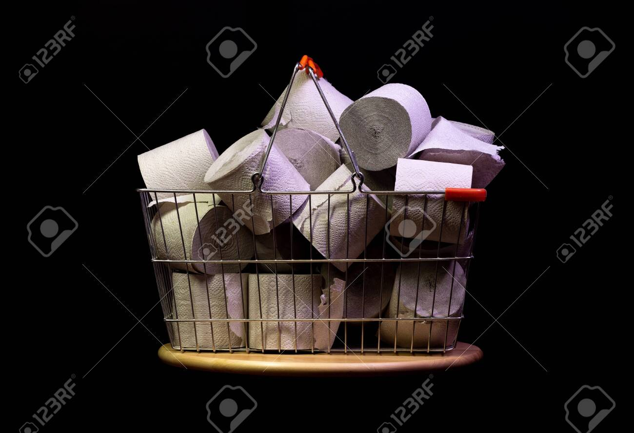 Shopping basket with rolls of toilet paper isolated on black - 144390491