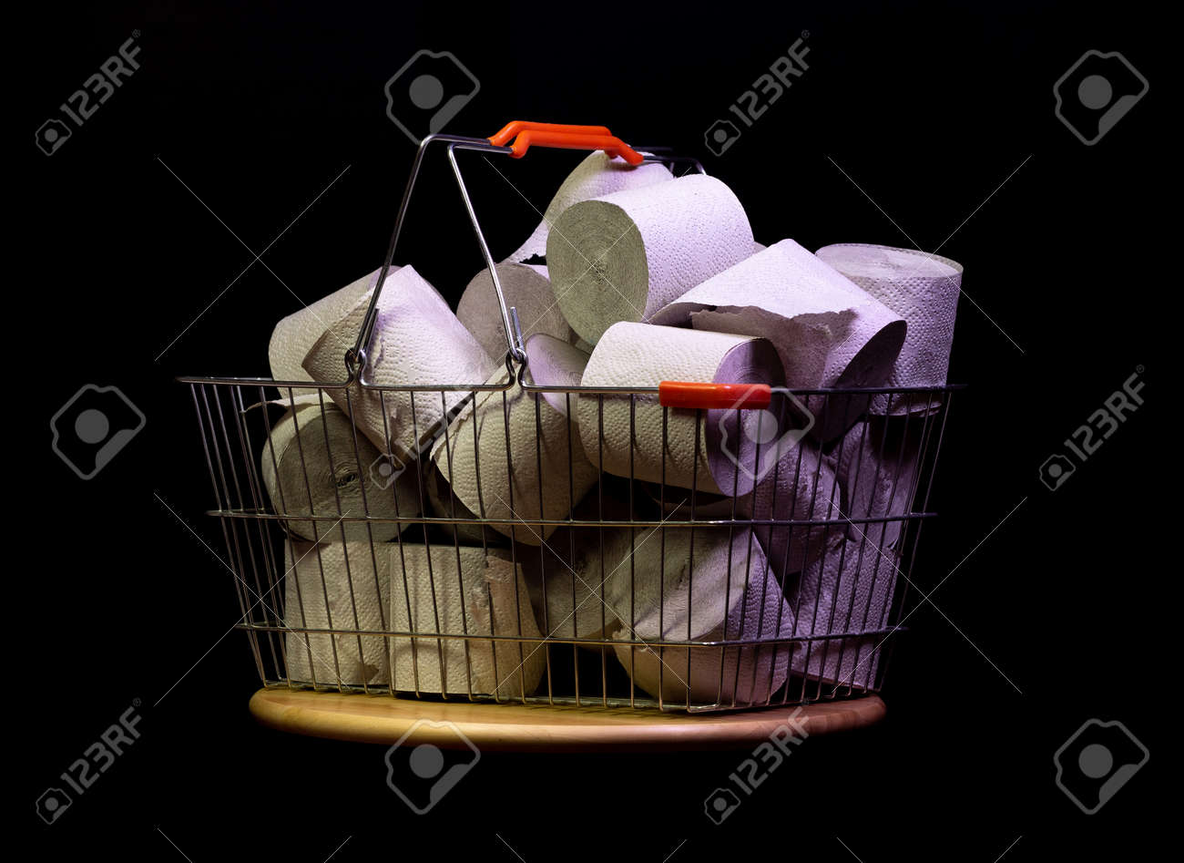 Shopping basket with rolls of toilet paper isolated on black - 144390486