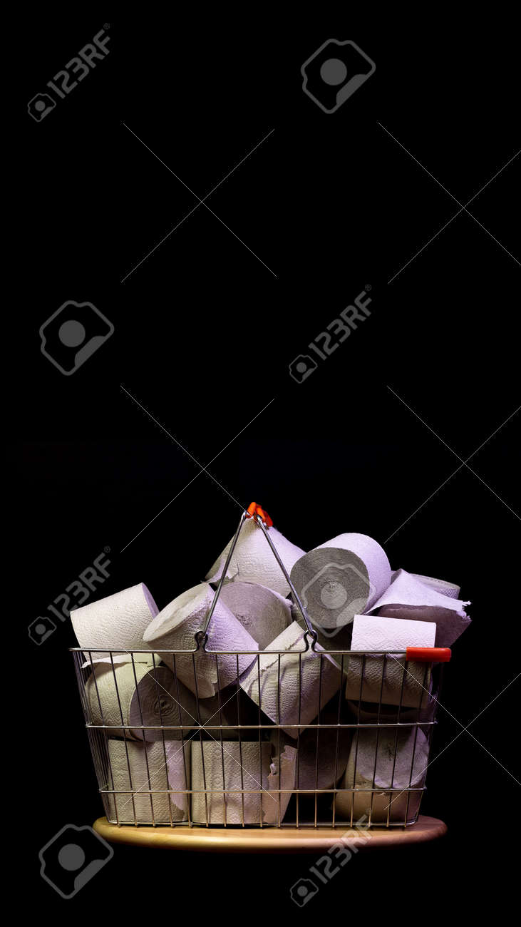 Shopping basket with rolls of toilet paper isolated on black - 144390487