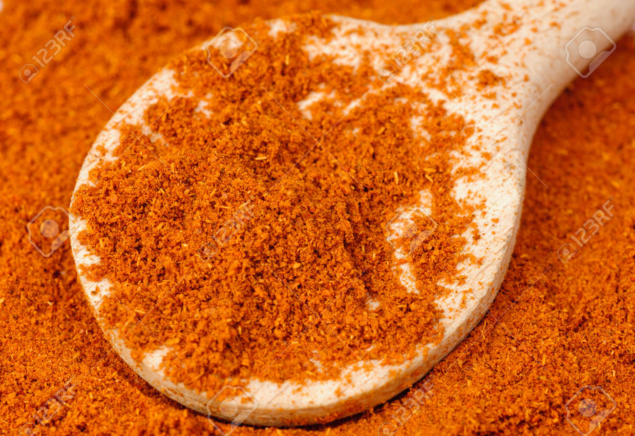 ground red pepper and wooden  spoon food background Stock Photo - 13462486