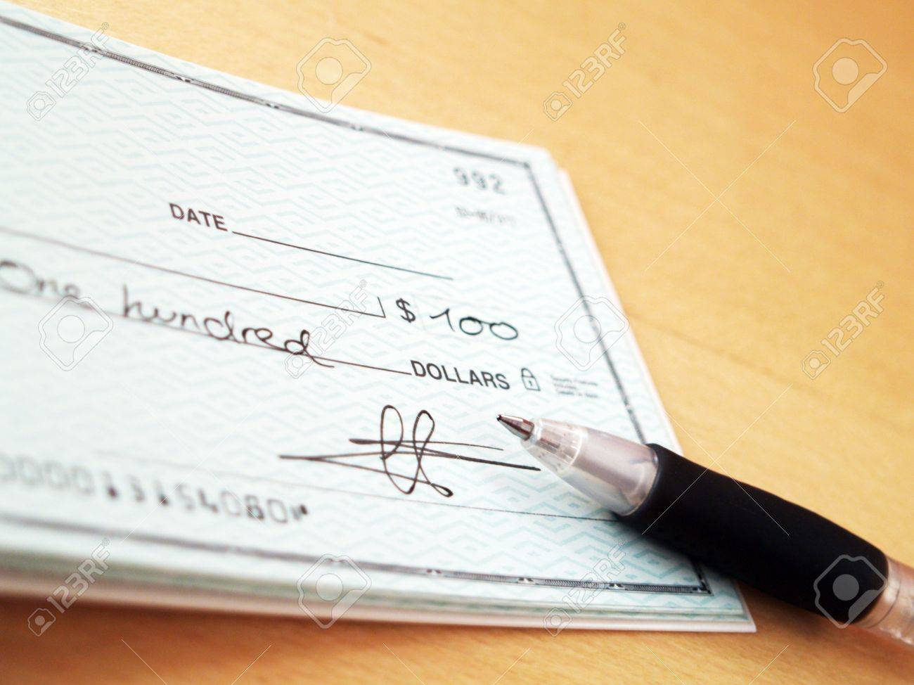 Signing A Check Stock Photo, Picture And Royalty Free Image. Image ...