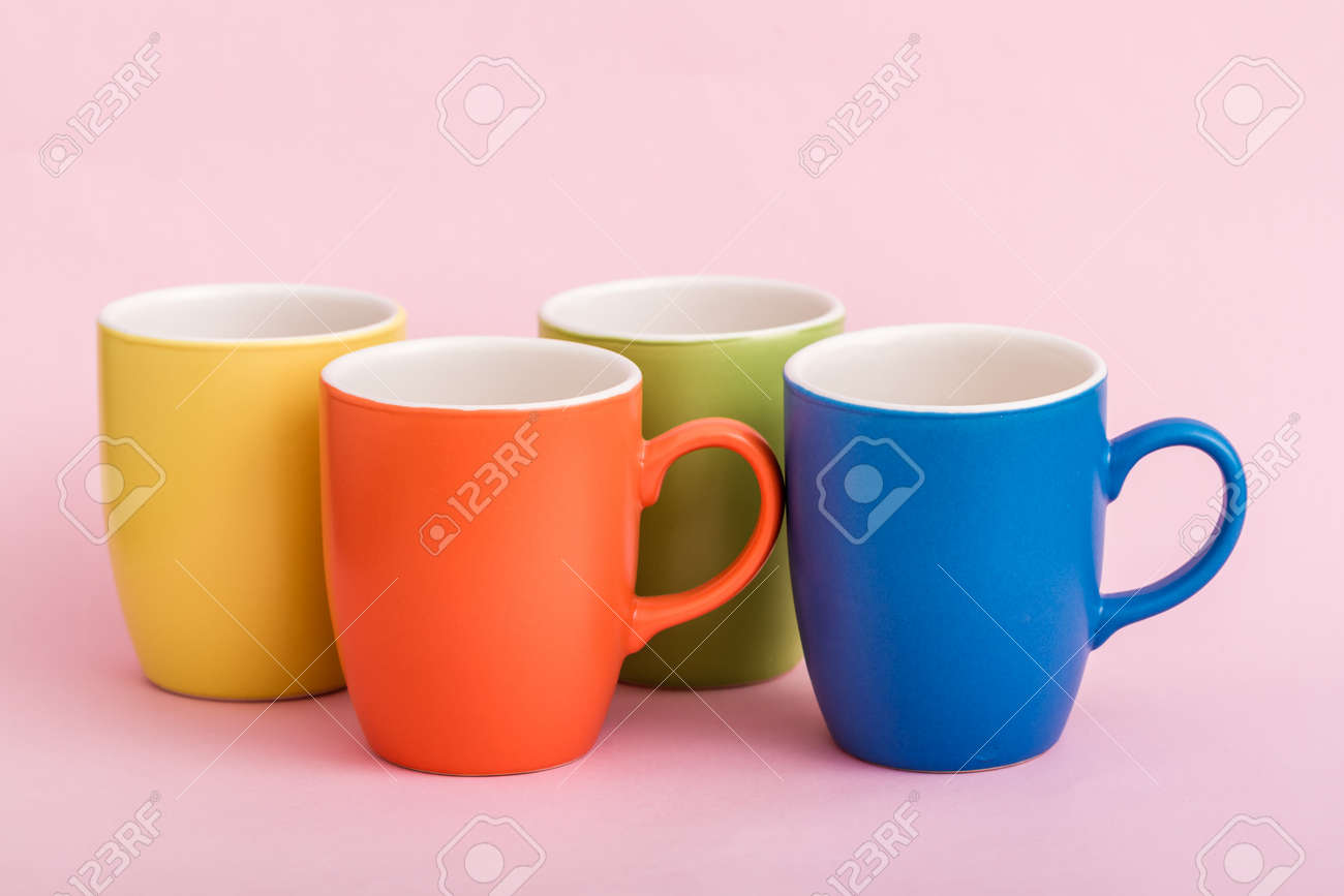 colorful coffee mugs on pink background stock photo picture and