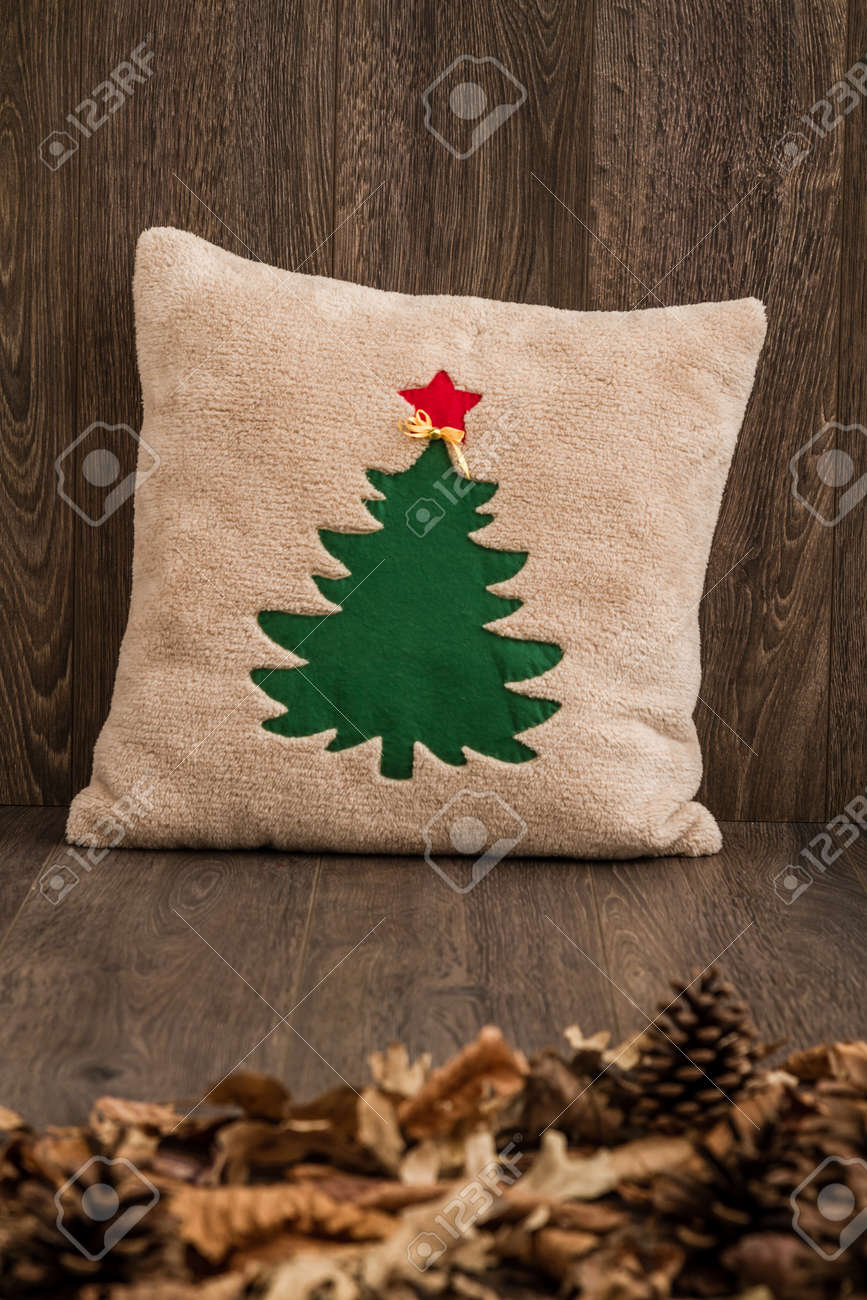 handmade pillow with christmas tree pattern on brown wooden background stock photo 92553321
