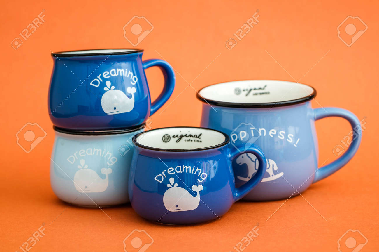 Creative Cute Coffee Mugs On Orange Background Stock Photo Picture And Royalty Free Image Image 99843653
