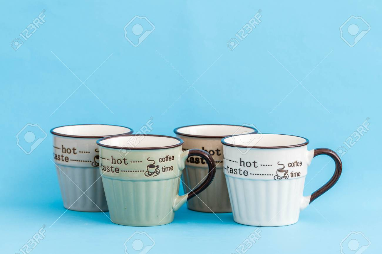 Creative Cute Coffee Mugs On Blue Background Stock Photo Picture And Royalty Free Image Image 99230458