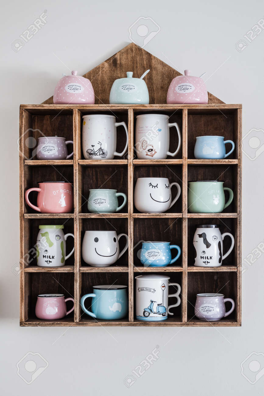 Ceramic Coffee Mugs On Handmade Wooden Rustic Wall Shelf Stock Photo Picture And Royalty Free Image Image 101221090