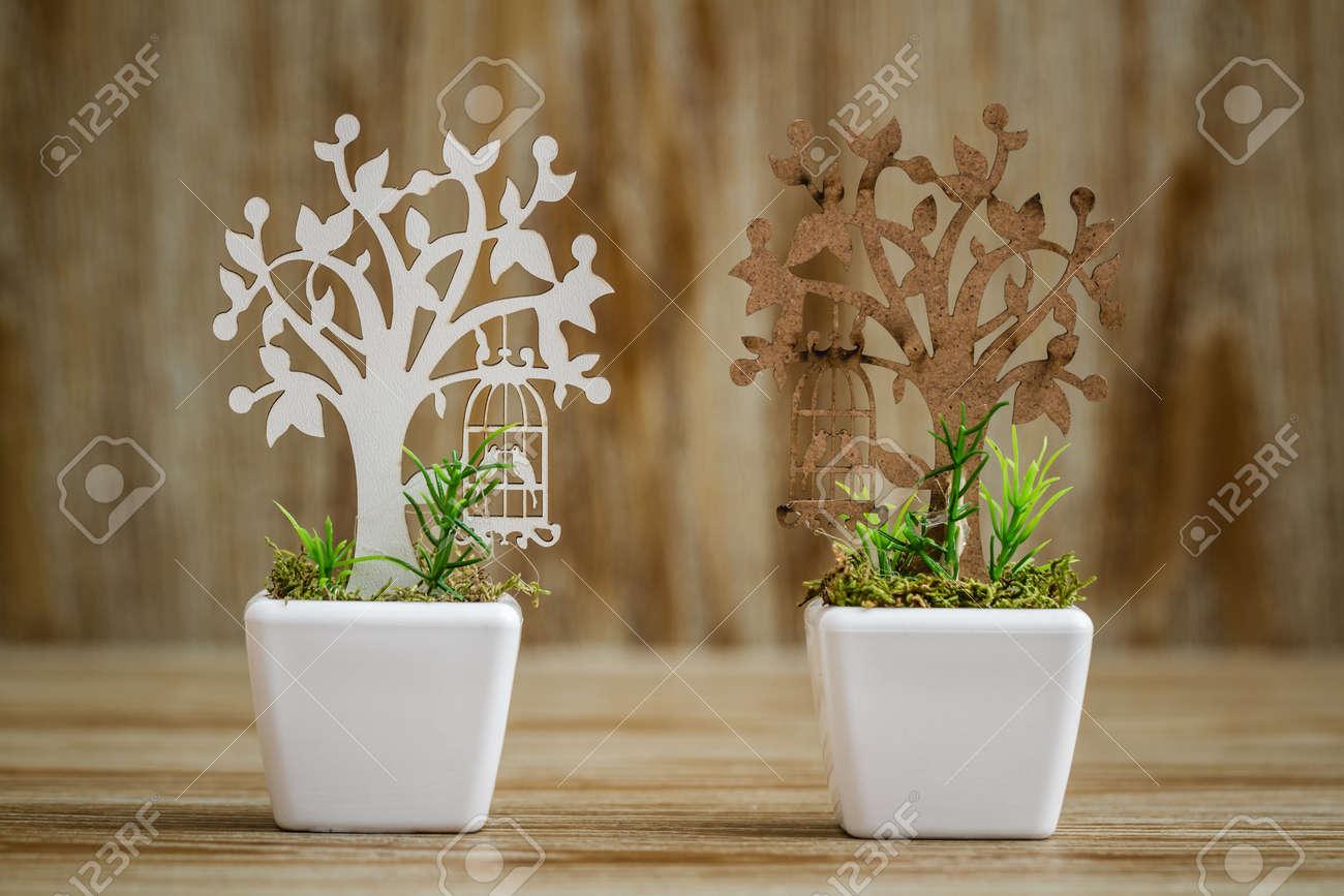 123RF.com & Laser cut wooden tree embellishments in white porcelain flower..