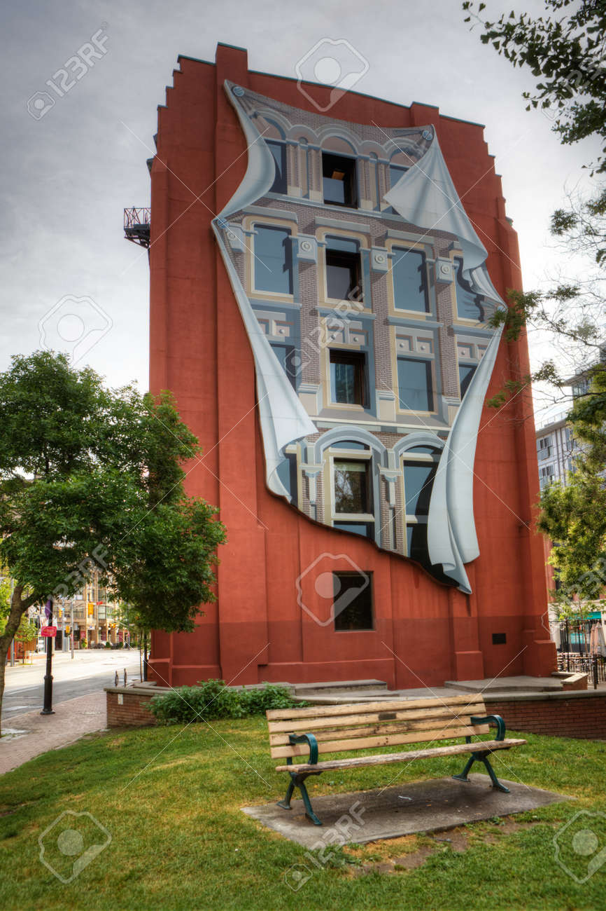 the flatiron building in toronto with trompe l oeil mural stock