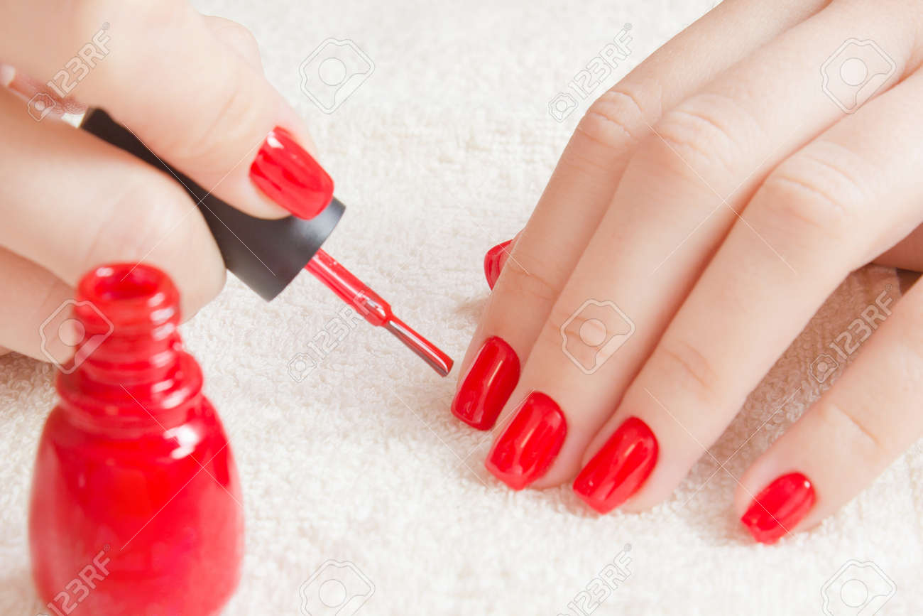 Manicure - Beautiful Manicured Womans Nails With Red Nail Polish ...