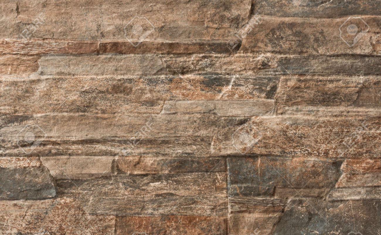 Mur En Pierre Interieur Beige ceci est une dalle de sol avec une texture de mur de pierre beige brun pour  bâtiment intérieur et extérieur