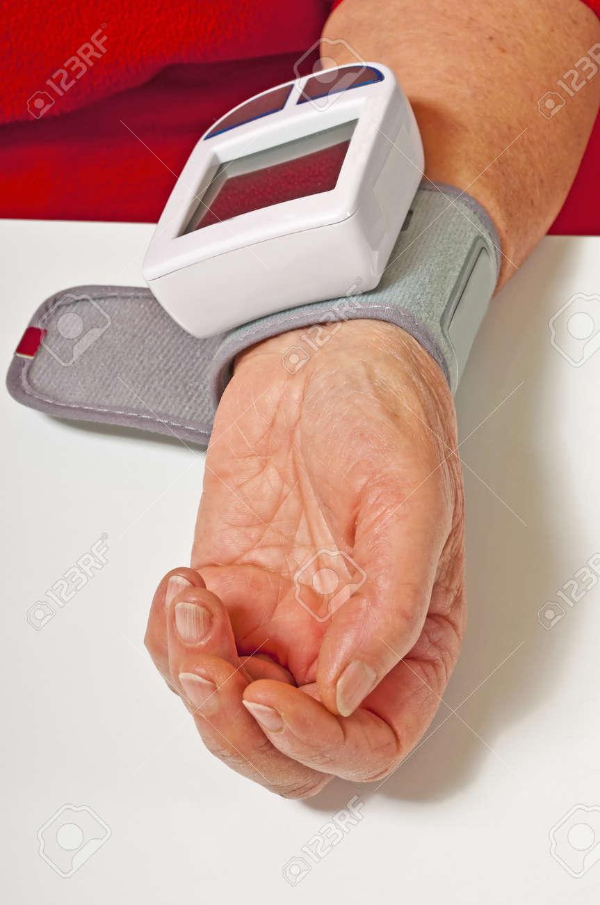 pensioner is measuring her blood pressure Stock Photo - 11859187