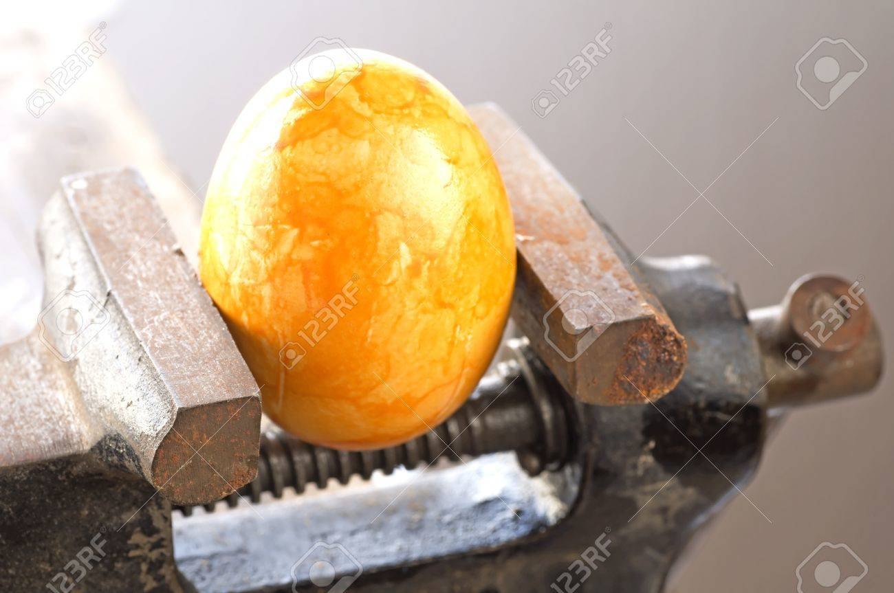 Egg in a bench vise Stock Photo - 18933859