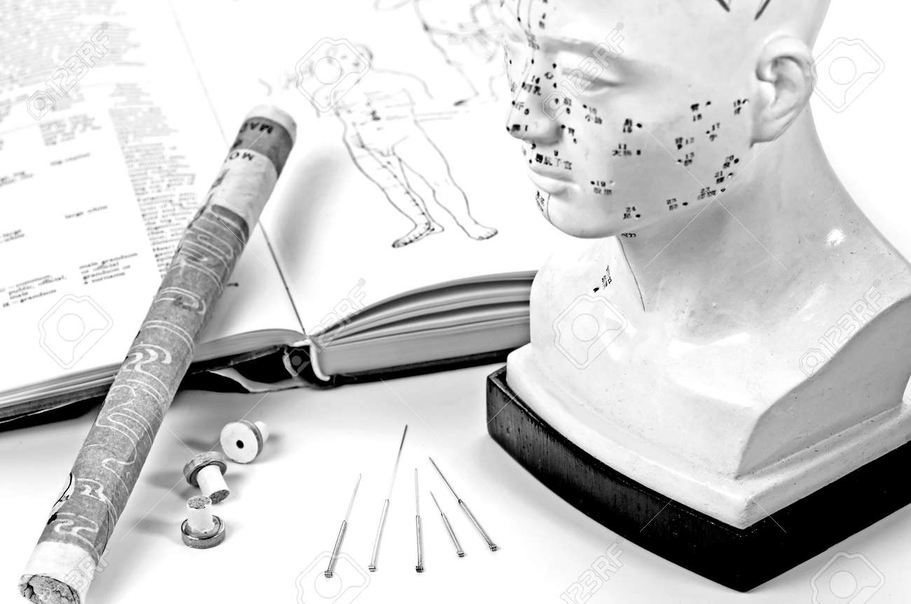 acupuncture needles,model and moxa cigar with textbook Stock Photo - 23964264