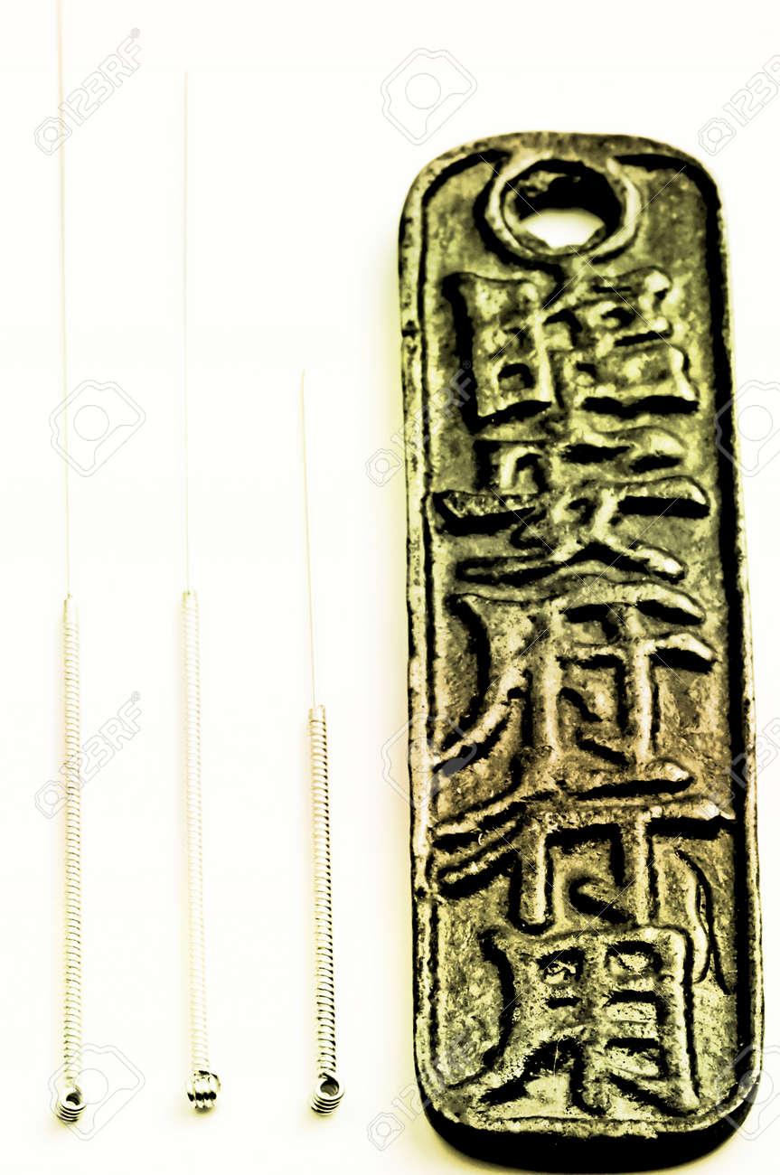 Acupuncture needles with antique chinese coin Stock Photo - 24760240