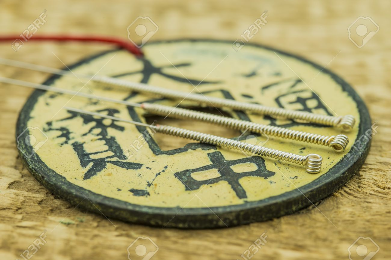 Acupuncture needles with antique chinese coin - 24972441