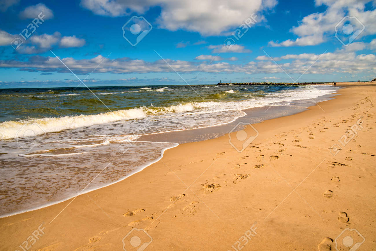 lonesome beach of the Baltic Sea with blue sky and clouds - 126601371