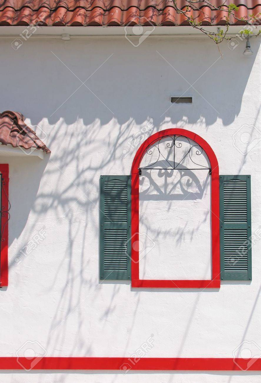 A False Window In Red With Green Shutters On Stucco Stock Photo   4331657