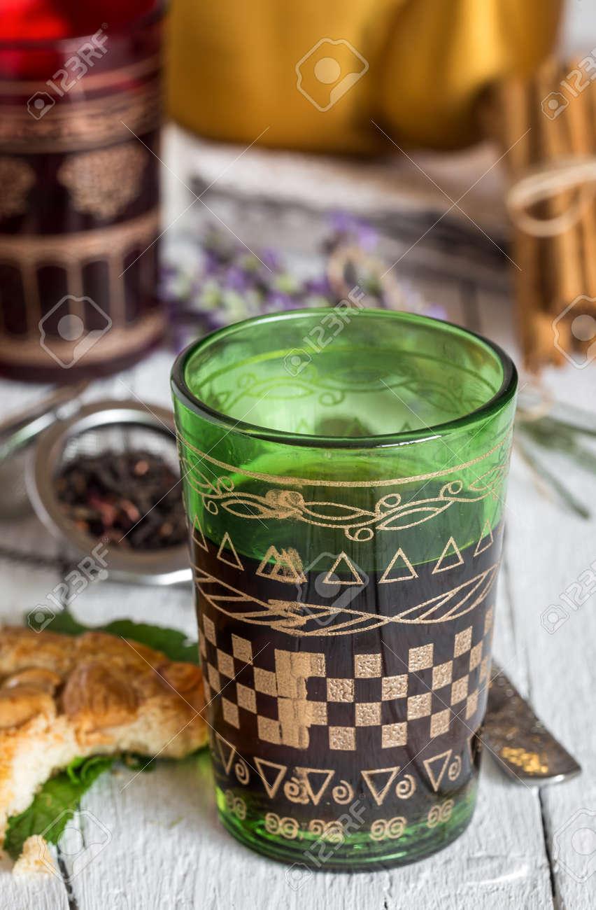 Arabic nana mint tea in traditional glass with mint, cinnamon,
