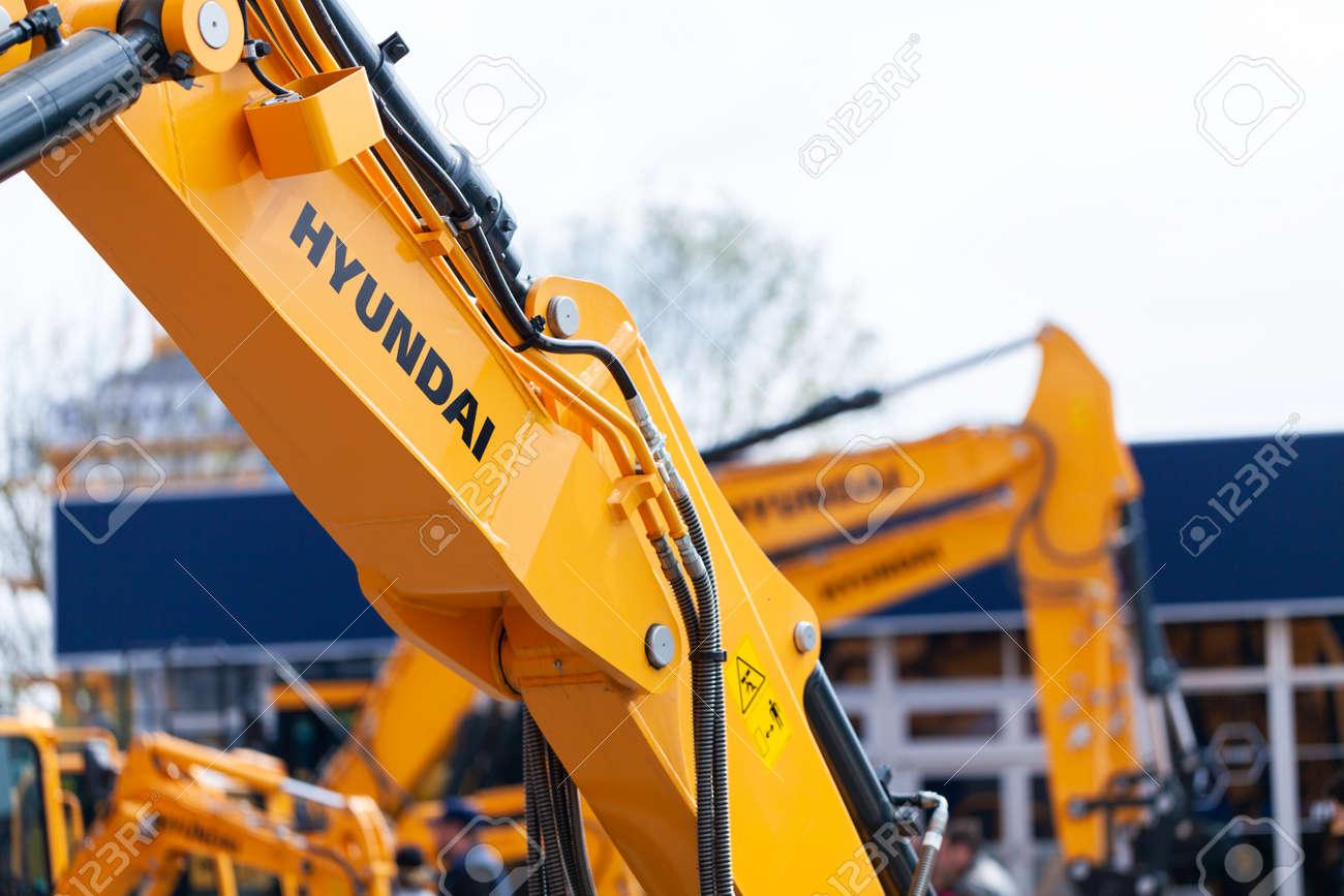 MUNICH / GERMANY - APRIL 14, 2019: Hyundai logo on a digger arm at a Hyundai machine dealer. - 120916187