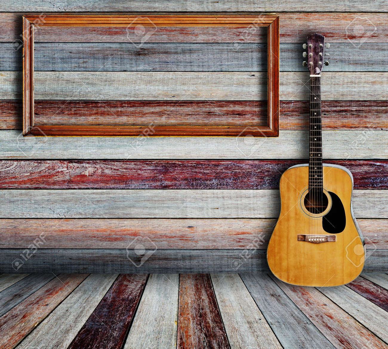 guitar and picture frame in vintage wood room stock photo 14783891