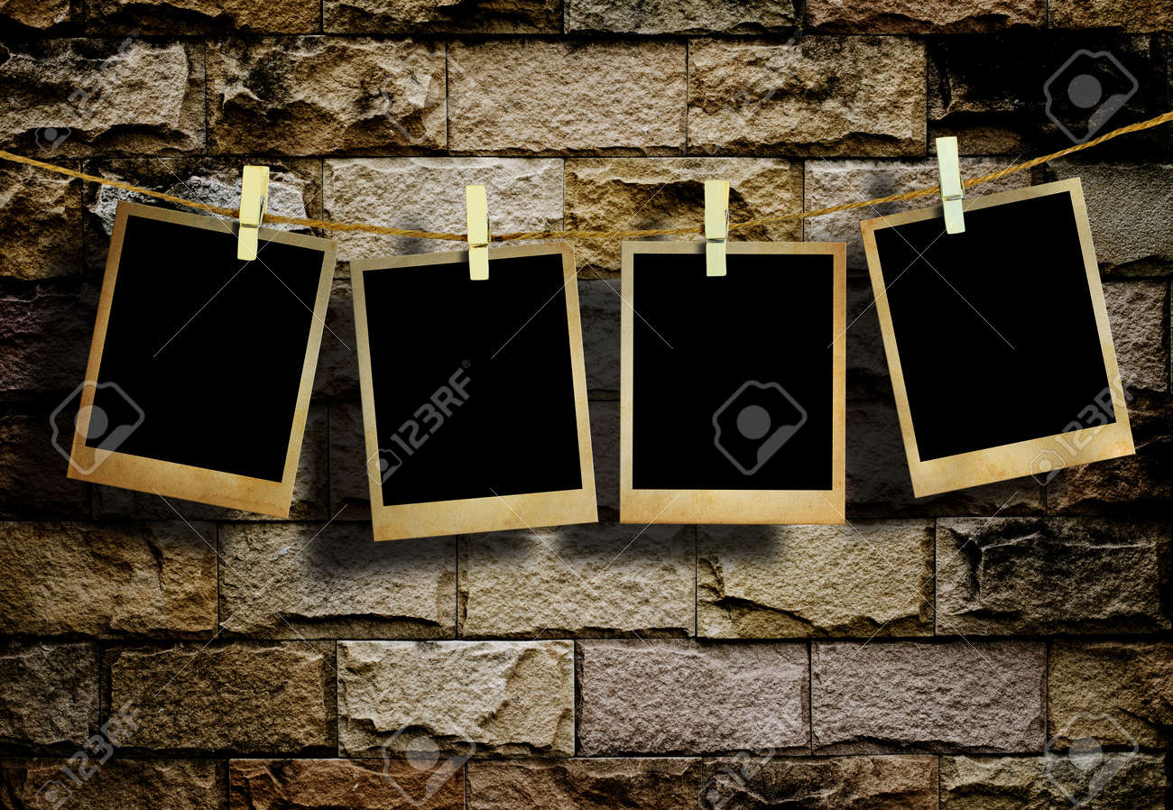 Old Picture Frame Hanging On Clothesline On Grunge Wall Stock Photo ...