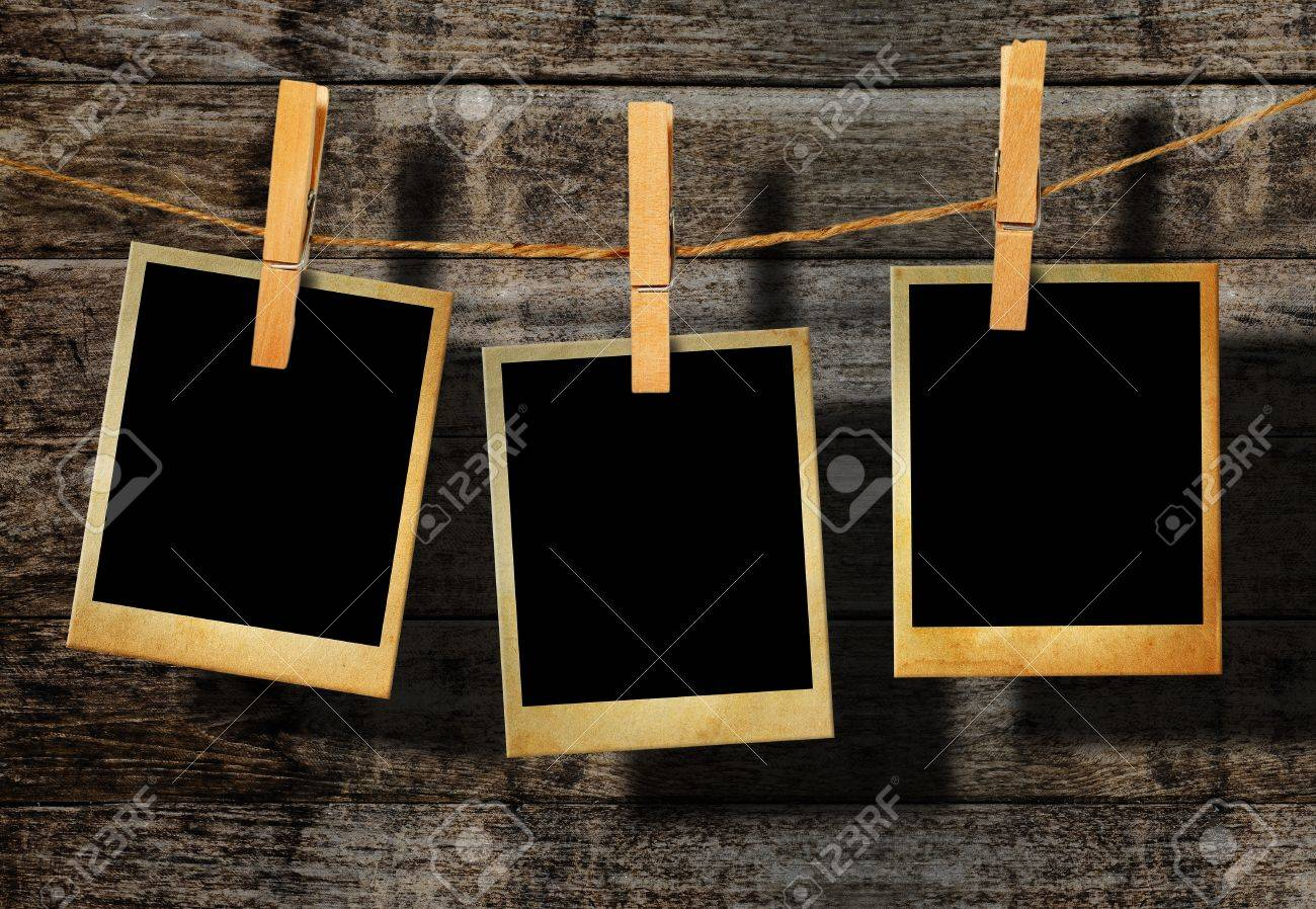 Old Picture Frame Hanging On Clothesline On Wood Background Stock ...