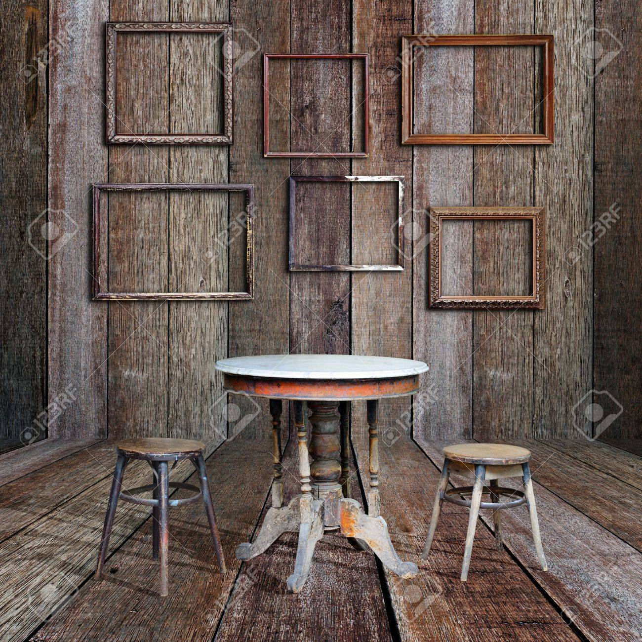 Picture frame and furniture in vintage wood room stock photo 16357376