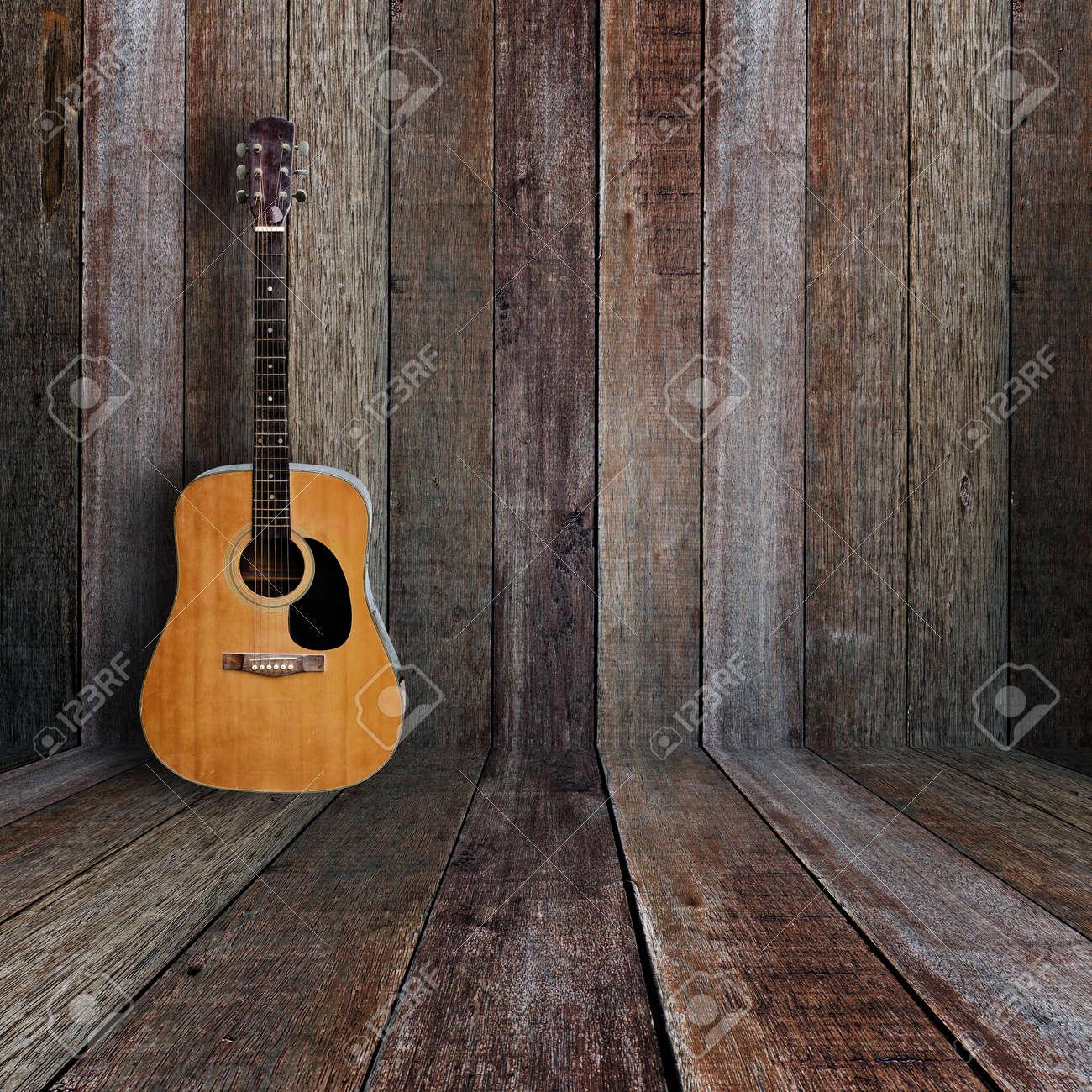 Guitar In Vintage Wood Room Stock Photo
