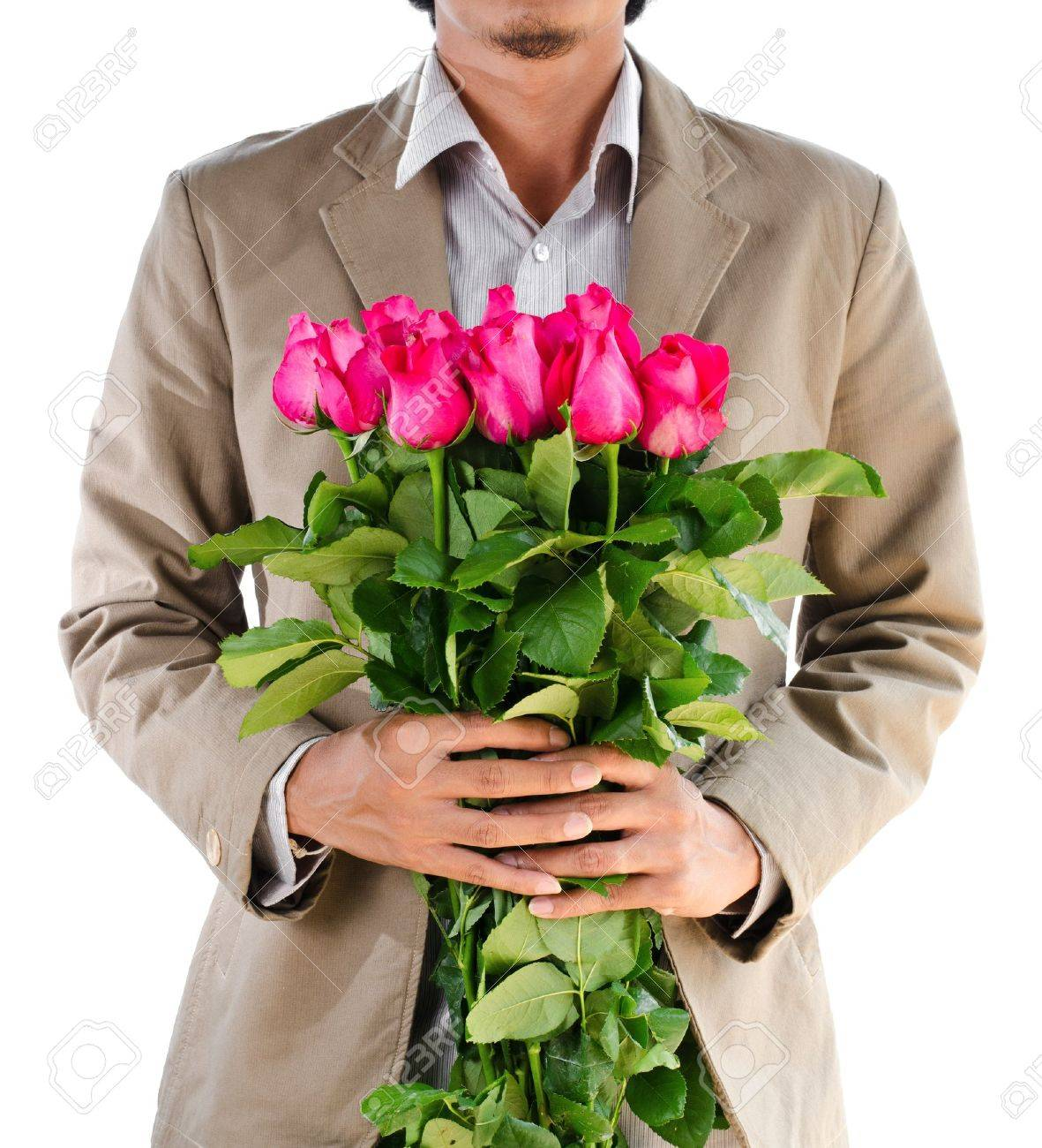 Man in suit holding a roses on white background. Stock Photo - 17452913