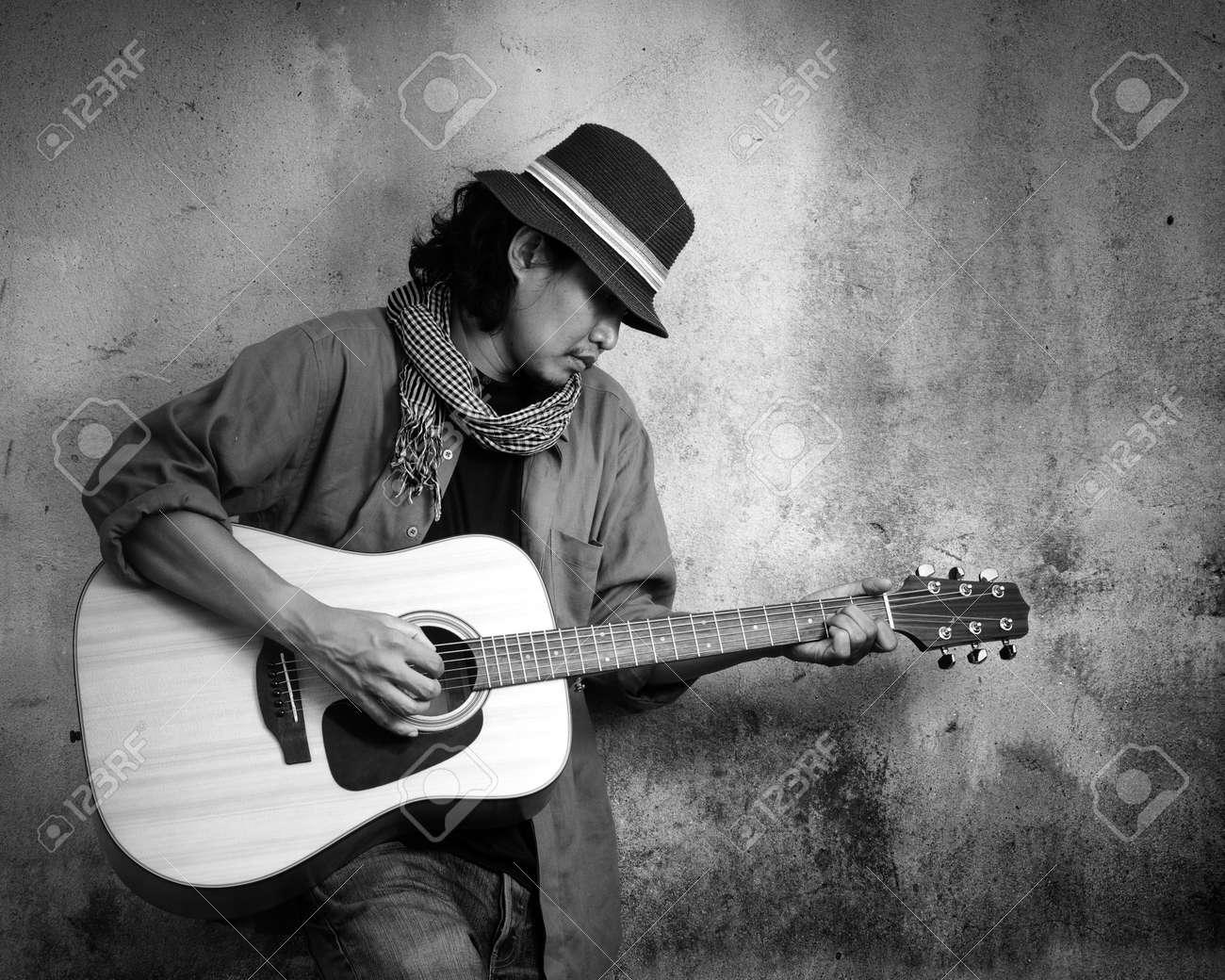 Man Playing Guitar Black And White Photo
