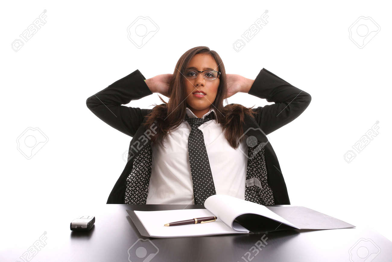 Successful businesswoman relaxing over her desk, isolated in white background Stock Photo - 3626953