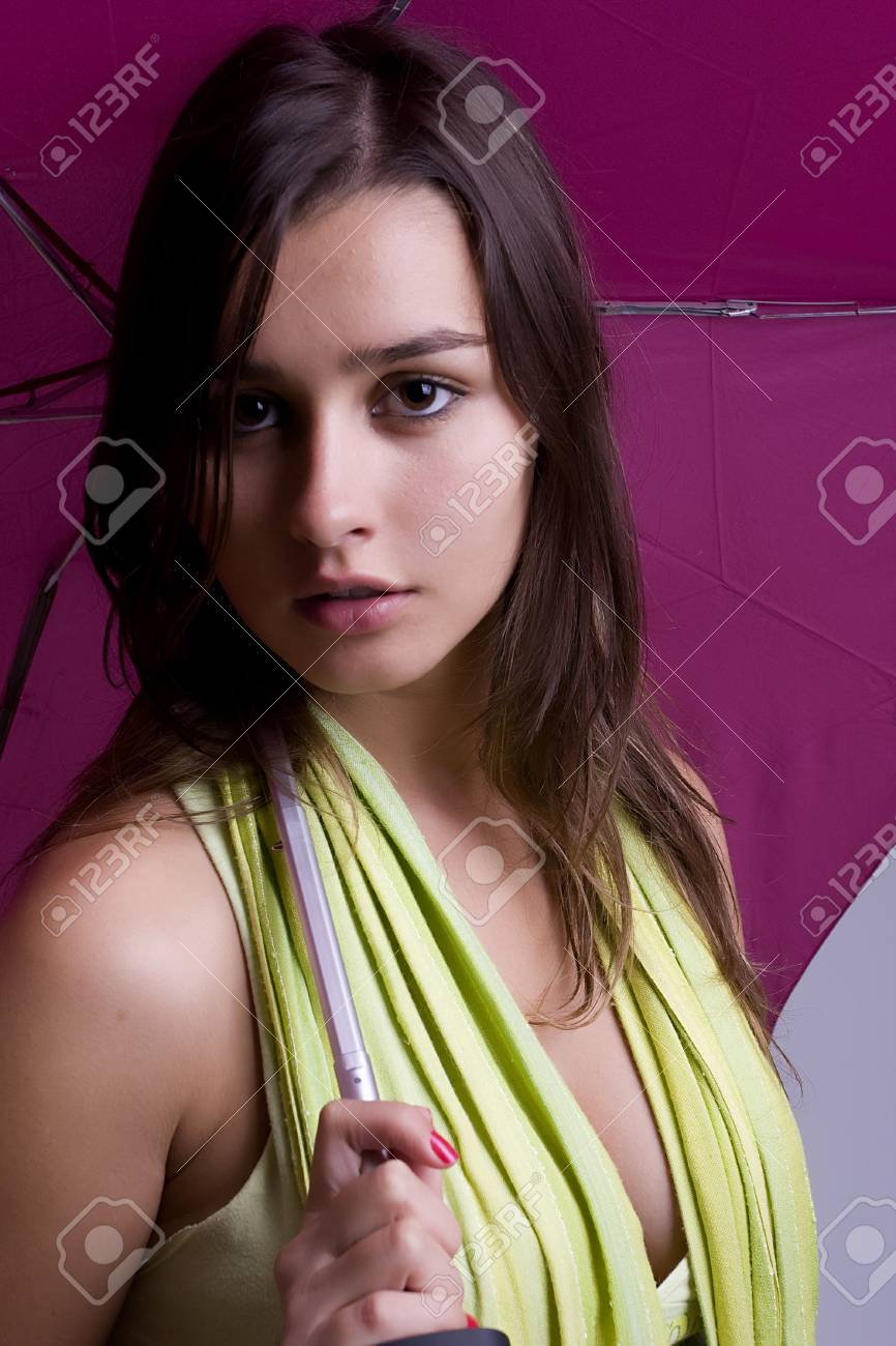 Young woman under an umbrella, posing isolated Stock Photo - 3997878