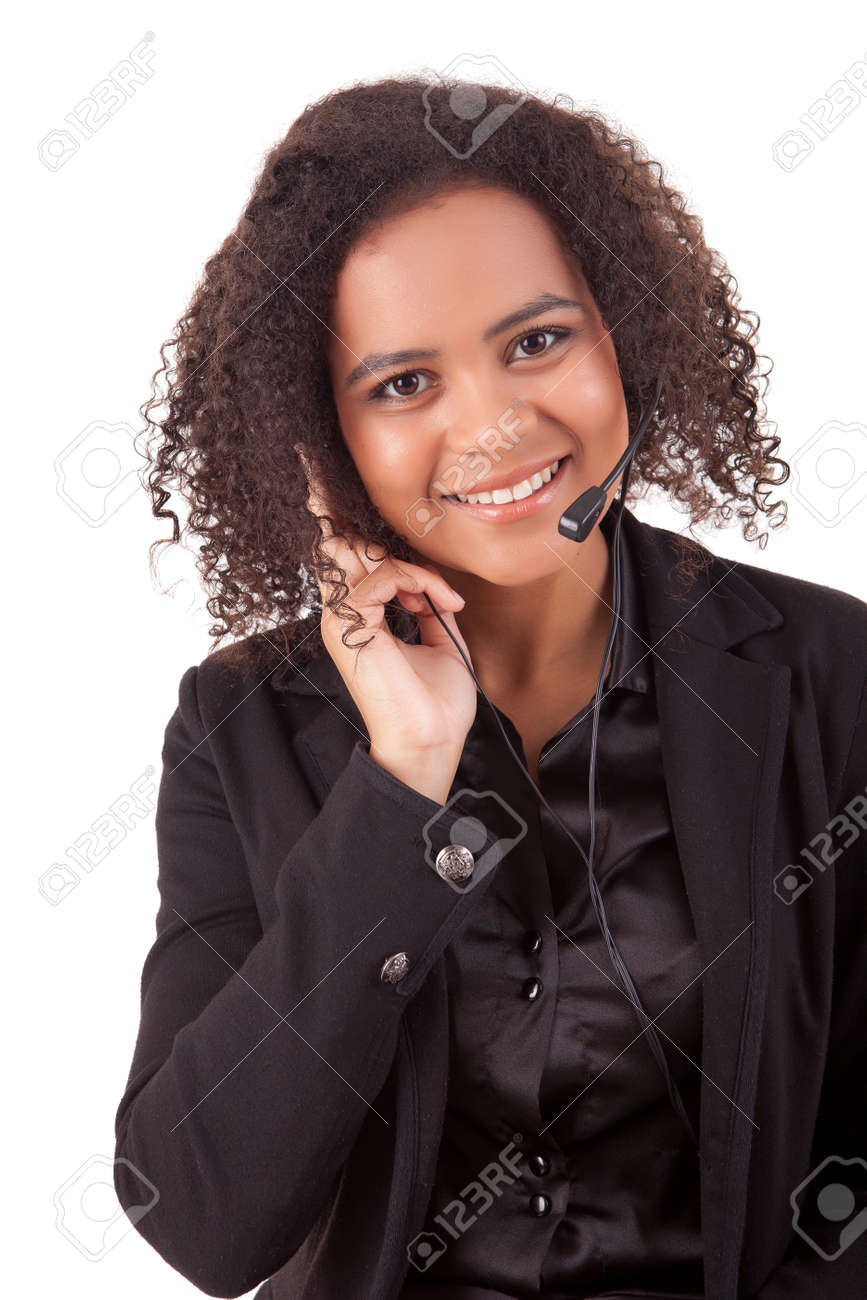 Friendly young beautiful telephone operator at work Stock Photo - 14104294