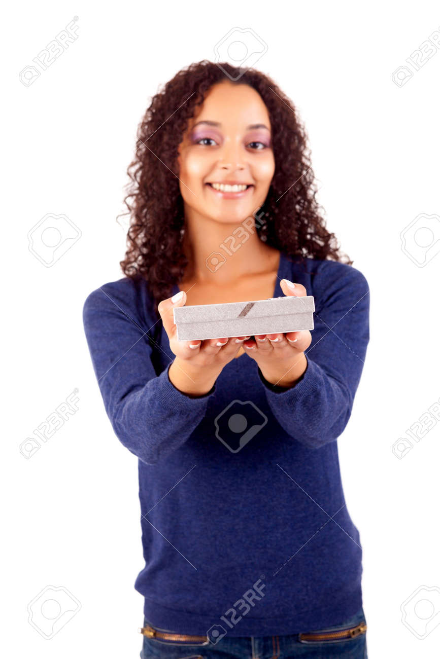 Happy young woman holding a gift, isolated over white Stock Photo - 16472665